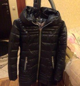 Женская куртка .пачти новая