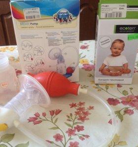 Молокоотсос и бандаж от пупочной грыжи малышам