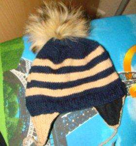 Шапка зимняя с пумпоном енота