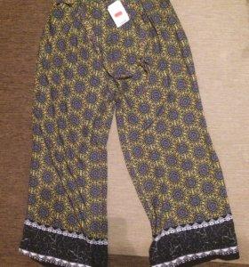 Лёгкие новые брюки Promod размер L