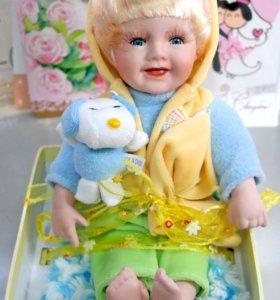 Фарфоровые куклы малыши