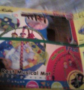 Игровой коврик ,видео диски с фильмами