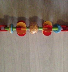 Замечательная игрушка на коляску /стульчик