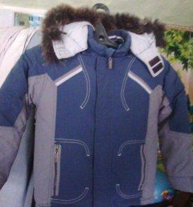 Куртка тёплая на 7-9 лет.