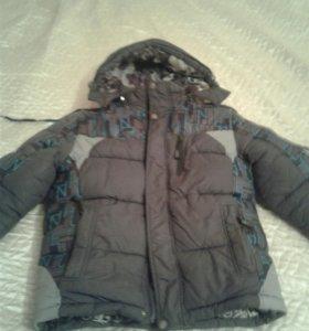 Зимняя куртка Б/У.с мехом. В хорошем состоянии.