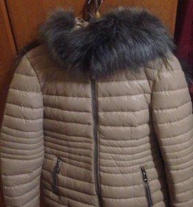 Продам новую зимнюю куртку 46-48 размер