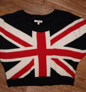 Много одежды свитера кофты