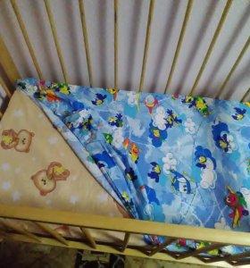 В детскую кроватку.