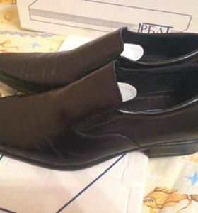 Абсолютно новые мужские туфли