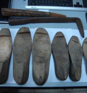 старые обувные колодки и лапа