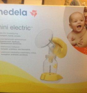 Электрический молокоотсос (новый).