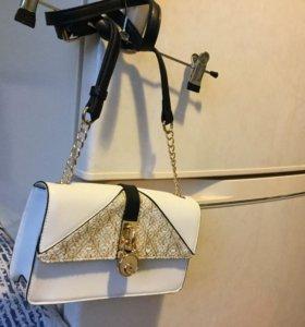 Клатчи и сумочки кошельки