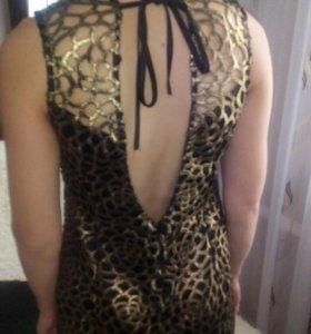 Вечернее платье с открытой спиной.