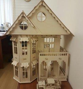 Кукольный домик с полным набором мебели.