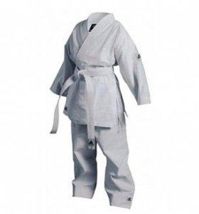 Продам кимоно для каратэ. Новый.  Размер 128.