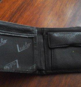 Мужской бумажник,б/у, в хорошем состоянии.