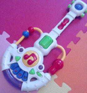 Детская музыкальная гитара