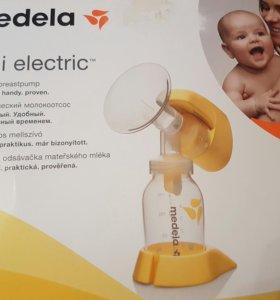 молокоотсо Medela mini electric