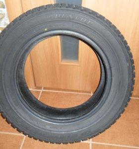 Зимние шипованные автошины Dunlop