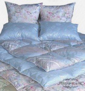 Подушки, одеяла и комплекты постельного белья.