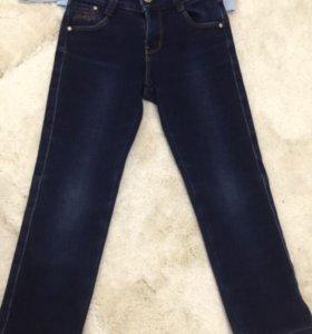 Утеплённые джинсы. Состояние новых.