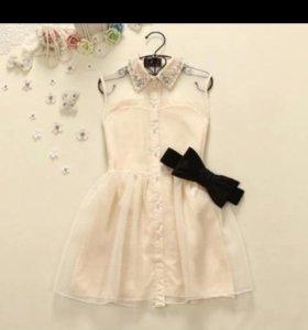 Новое платье белого цвета