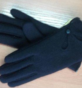 Новые женские перчатки .