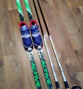 Продаю или меняю Лыжи с ботинками и палками новые