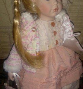 Виниловая кукла