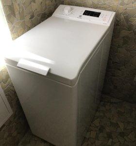 Узкая стиральная машинка с вертикальной загрузкой