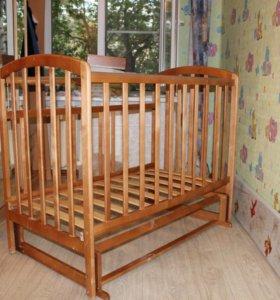 кроватка детская с маятником