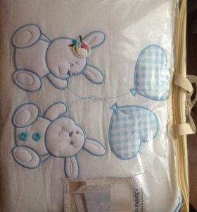 Новый комплект в кроватку