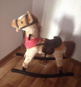 Музыкальная лошадка качалка