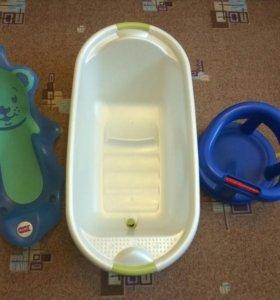 Ванночка,горка,стульчик и круг для купания.