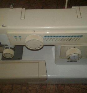 Новая швейная машина