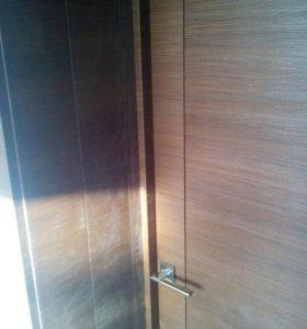 Установка дверей, укладка ламината.