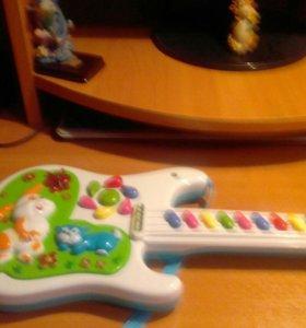 Игрушечная музыкальная гитара