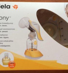 Молокоотсос ручной ф.Medela+подарок