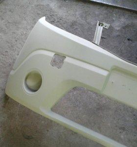 Передний бампер рено сандеро 2012г.