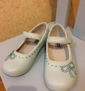 Новые голубые туфли