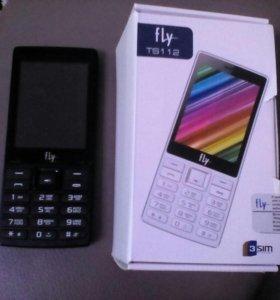 Новый телефон на гарантии fly  TS112