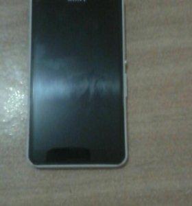 Телефон  Sony Е 2003