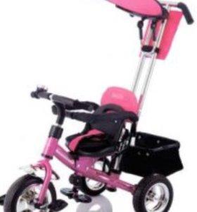Велосипед детский с ручкой, фирмы Лексус.