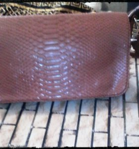 Продам новую рыжую сумку качественный кожзам .
