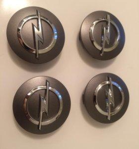 Новые оригинальные колпачки на литые диски опель