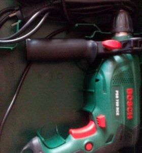 Дрель ударная Bosch pan 750 rce