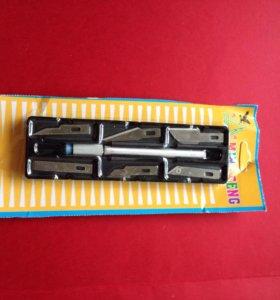 Ручка со сменными лезвиями