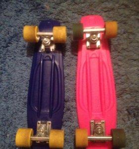 Розовый скейтборд