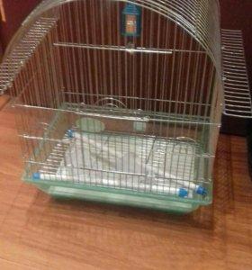 Продам большую клетку для попугаев практически нов