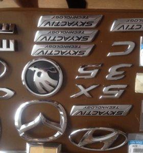 Эмблемы на авто
